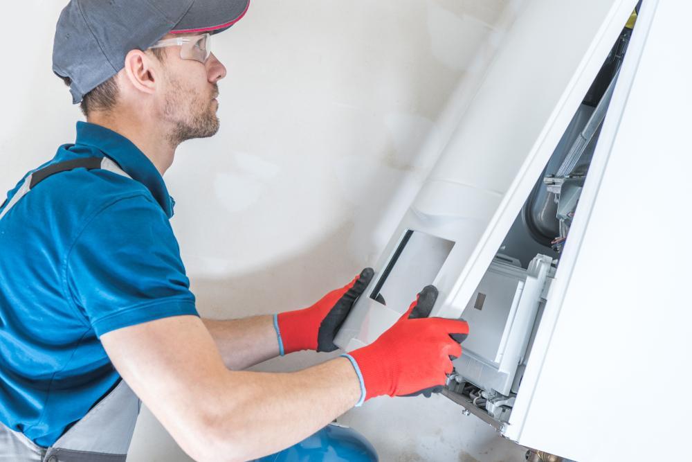 Man replacing panel of a furnace