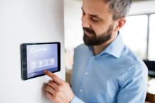 man changing smart thermostat, smart thermostat, home comfort