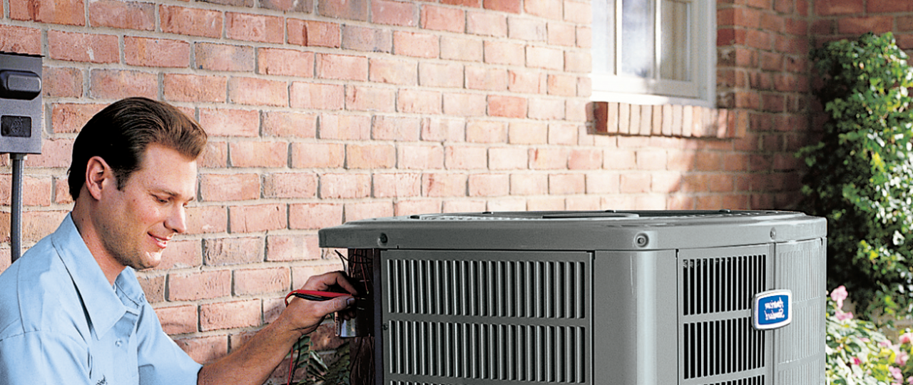 technician servicing an air conditioner
