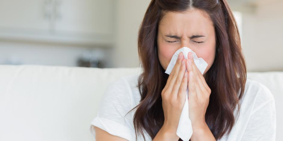 woman at home sneezing