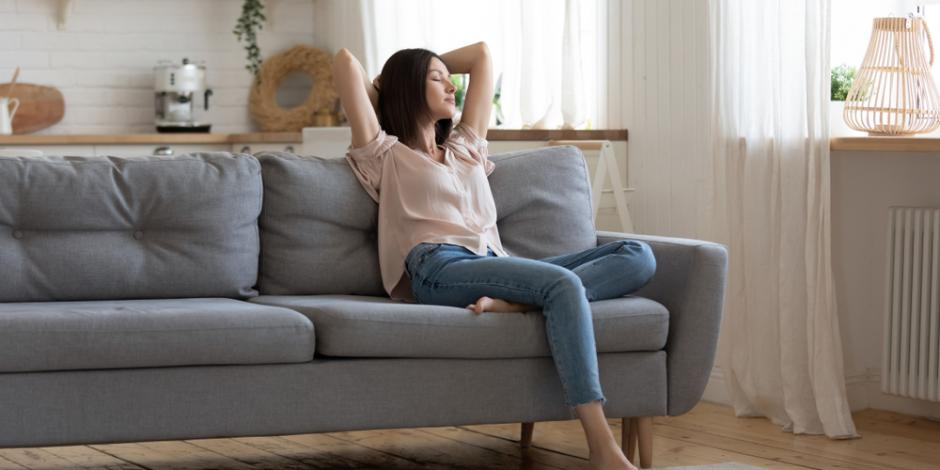 woman breathing fresh air at home on couch